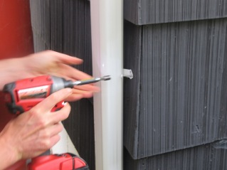 Unscrew the downspout attachment